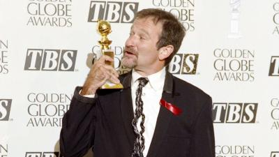 (FILES) A file picture taken on January 22, 1994 in Beverly Hills, shows US actor Robin Williams posing with his best actor in a musical or comedy award during the Golden Globe ceremony. Oscar-winning actor and comedian Robin Williams was found dead at hi